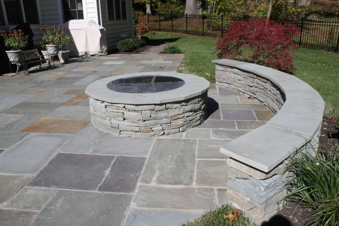 Bluestone Patio With Colonial Stone Dry Stacked Wall.