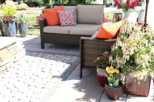Get outdoor patio furniture like this sectional couch with accent pillows at Burkholder's Showroom
