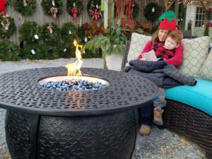 cozy around a fire table Burkholder Pop-up Holiday market