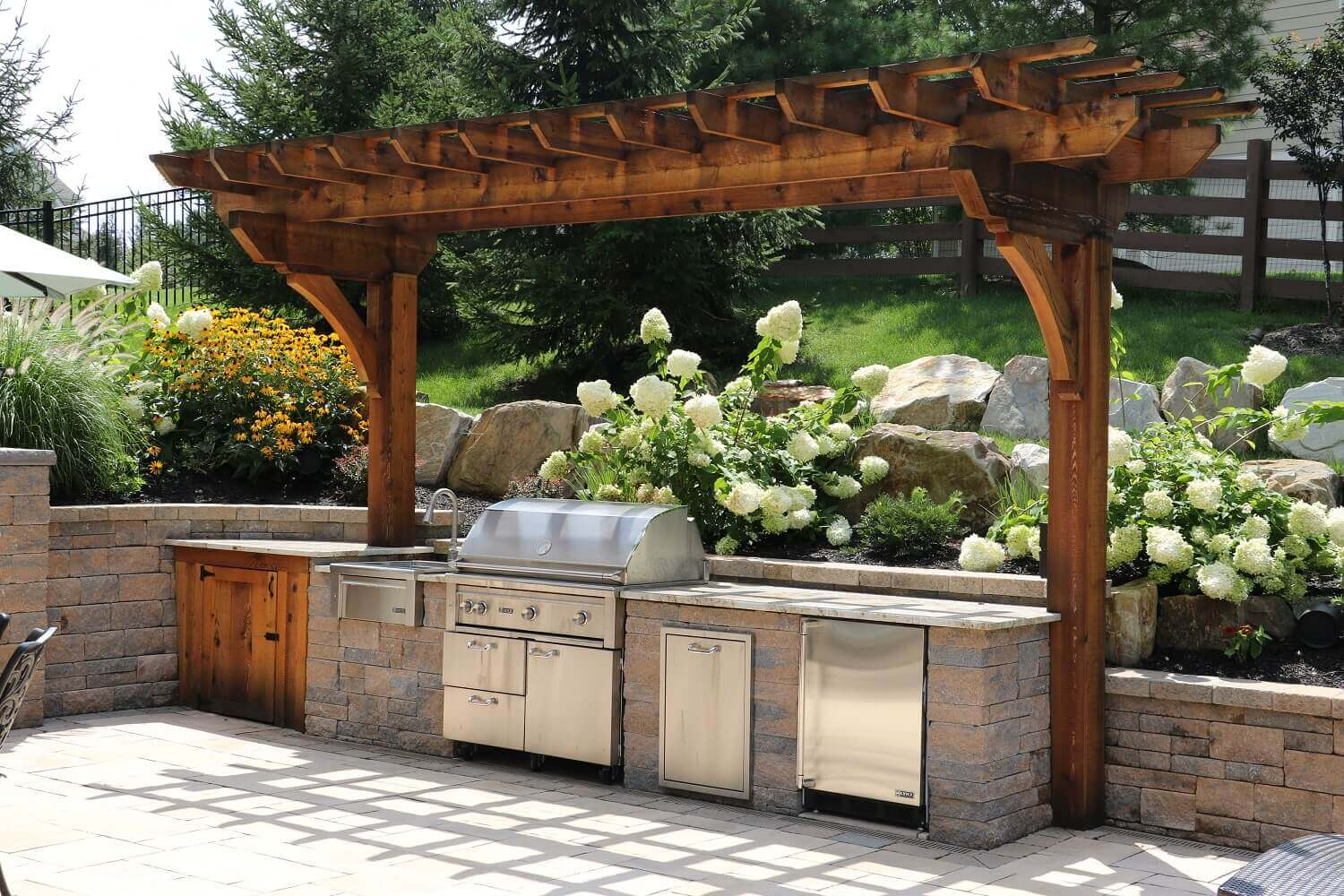 outdoor kitchen pergola free standing techobloc outdoor kitchen with sink gas grill trash and fridge cedar pergola cabinet custom built kitchens grills burkholder landscape