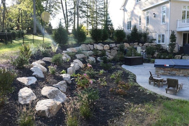 Retaining soft planting boulder wall   February landscaping tips   Burkholder Brothers
