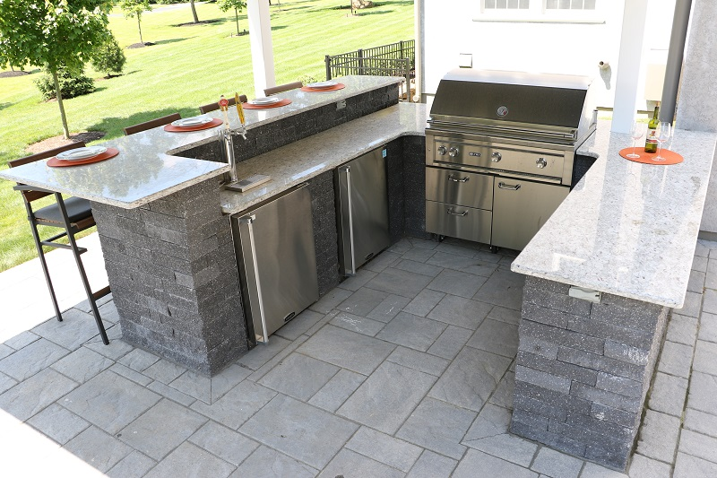 Outdoor Kitchen with the works - Island with bar height seating grill, refrigerator and beer tap - Burkholder