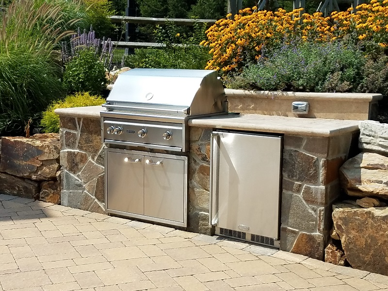 Trends in outdoor kitchens and grills - Grill with refrigerator and counter top- Burkholder