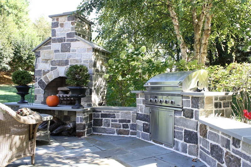 Outdoor kitchen with grill and fireplace - Burkholder