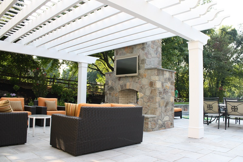 Double sided fireplace with entertainment system and pergola | comprehensive landscape services | Burkholder Brothers