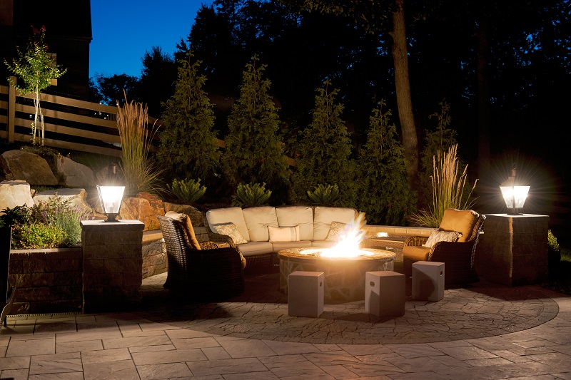 Outdoor firepit with furniture and lighting | Holiday Tips | Burkholder Brothers