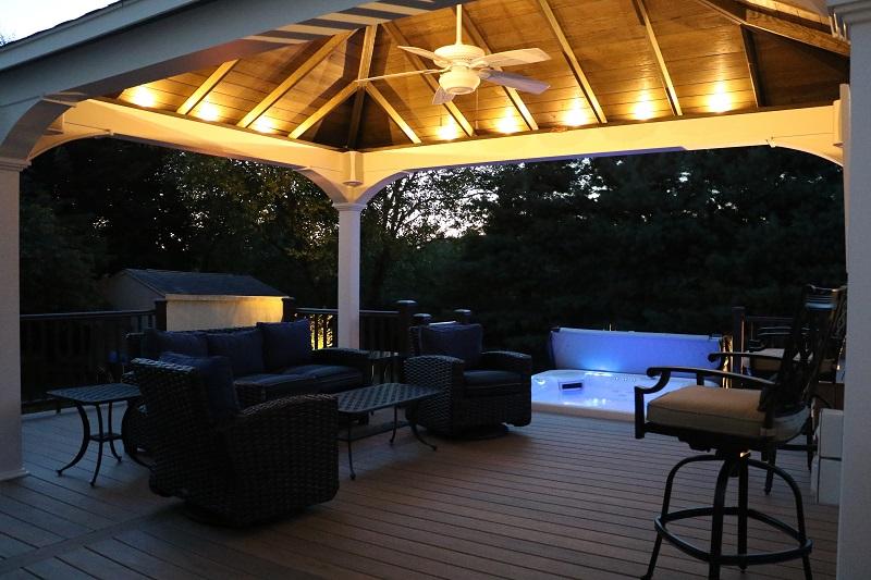 Outdoor lighting used in pavilion at night | 2020 Landscape Lighting Trends | Burkholder Brothers