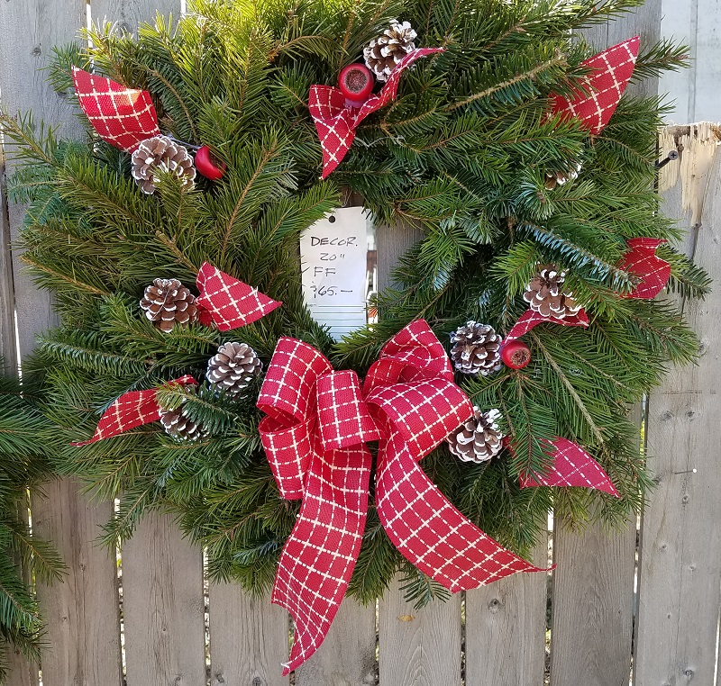 Wreath with red plaid bow and pine cones at the Burkholder Holiday Pop Up Market