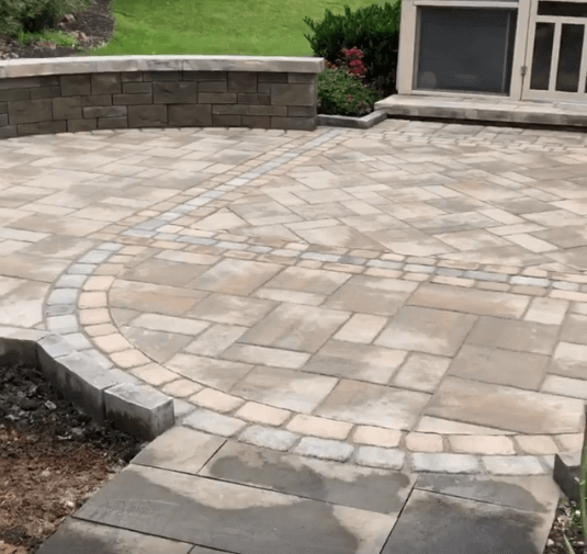 Photo of a patio with flagstone pavers | New Landscaping Projects | Burkholder Brothers