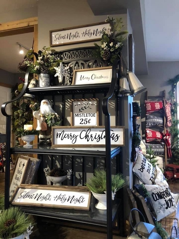 Burkholder Holiday Market, wall plaques and pillows on shelf | ways to get into the holiday spirit | Burkholder Brothers